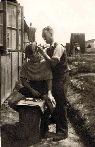 Cutting hair at Stalag 383, 1944