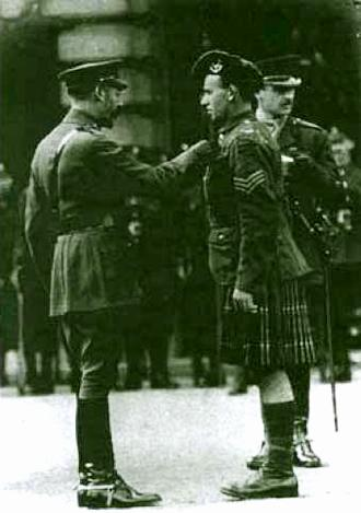 Sgt. Edwards receiving VC from King George