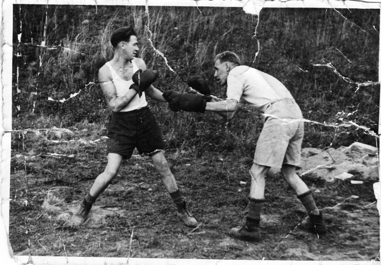 G. Drummond (right) Boxing in POW camp