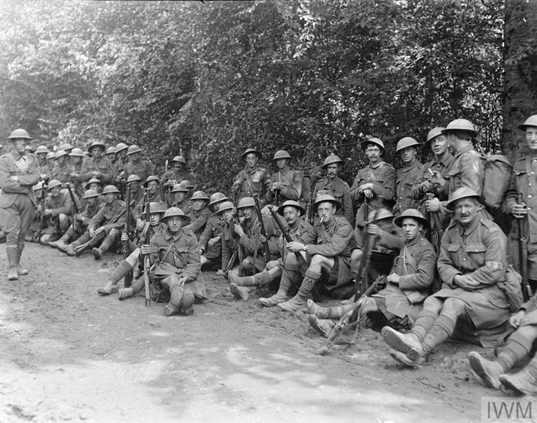 Men of 6th BW resting on the road back to St. Imoges