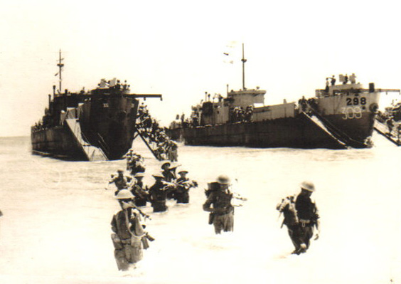 Men walking ashore, Sicily, July 1943
